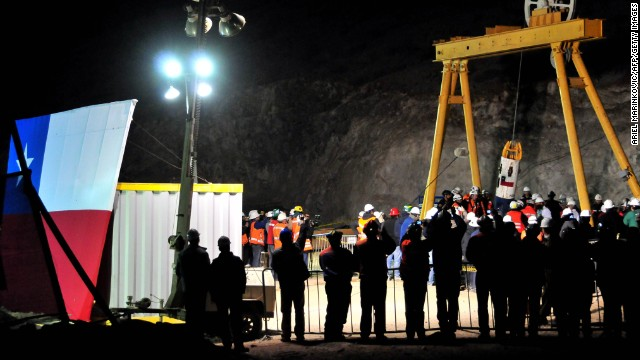 A capsule carrying a rescued miner surfaces on October 13, 2010, by the collapsed San Jose mine in Chile.