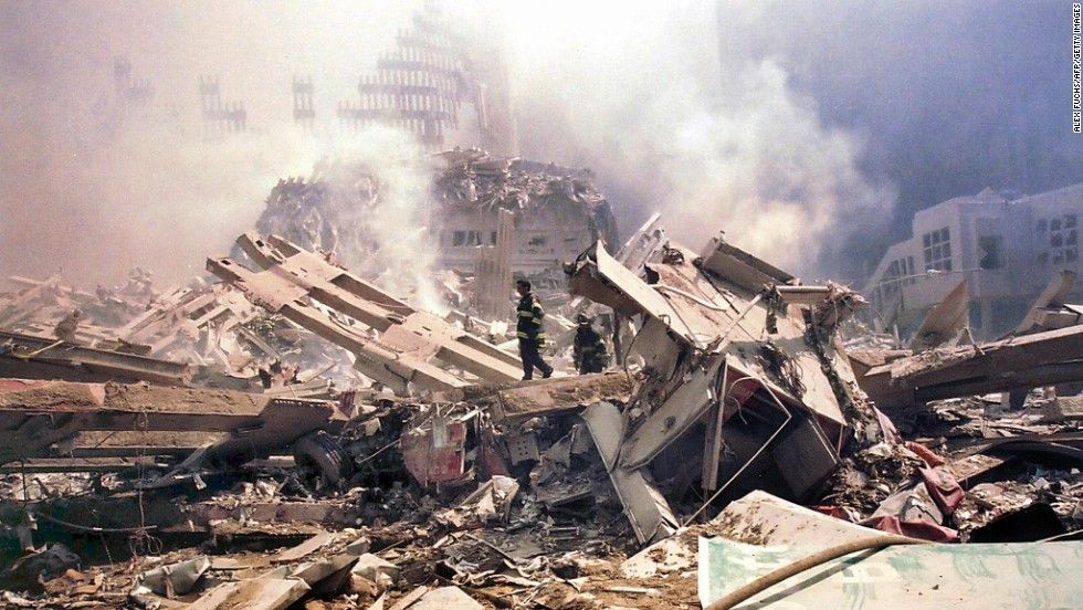 "<a href=""http://www.time.com/time/magazine/article/0,9171,1003216,00.html"" target=""_blank"">Genelle Guzman-McMillan</a> is rescued from the debris of the World Trade Center 26 hours after the terrorist attack on September 11, 2001. She worked on the 64th floor of the north tower and was walking down a stairwell when the building collapsed. Her body was protected in an air pocket."