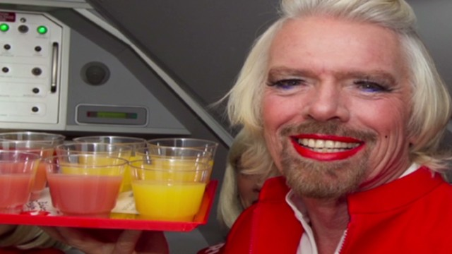 Richard Branson dons dress to settle bet