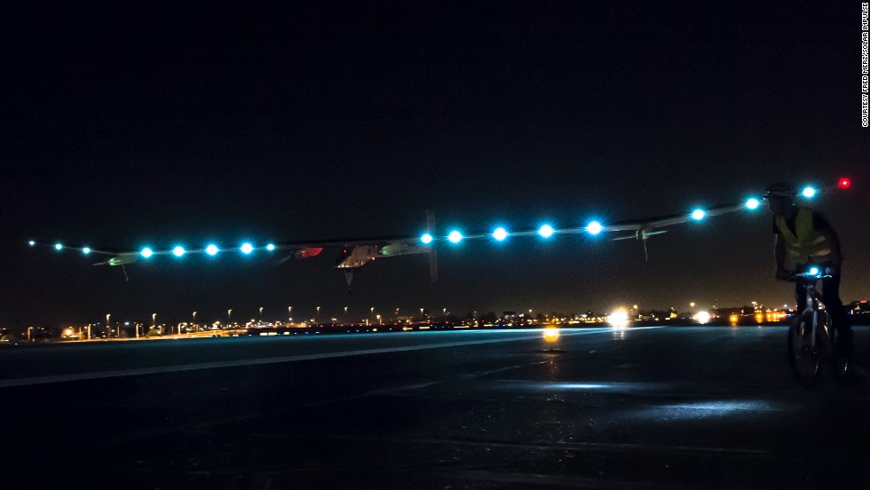 Solar Impulse, lit with more than a dozen solar-powered lights, touches down at Phoenix Sky Harbor Airport on May 3. It's the first aircraft to fly for 24 continuous hours only on sun power.