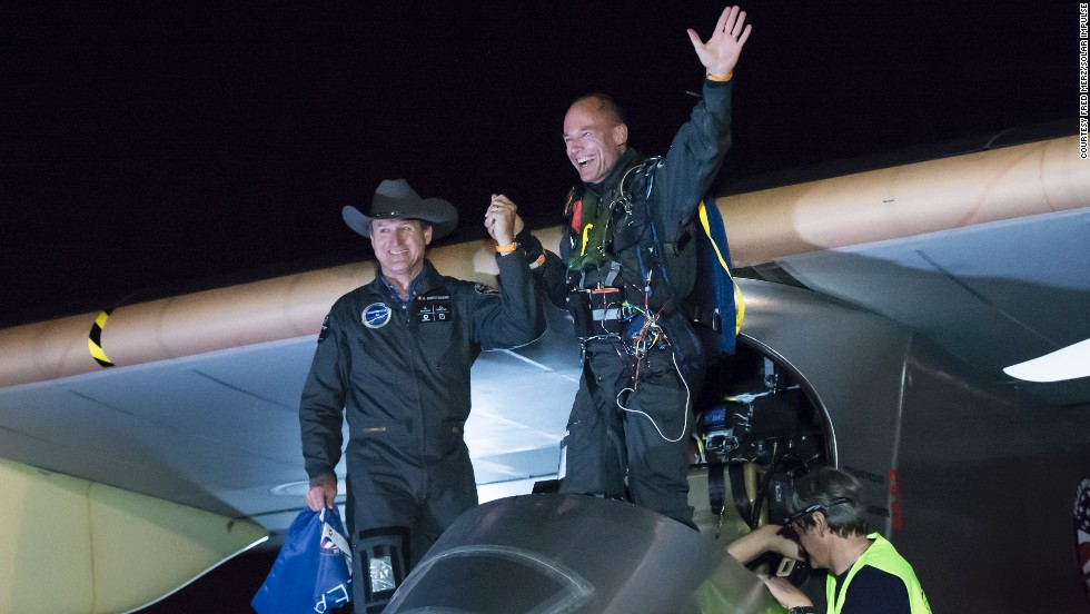 Solar Impulse co-pilots Andre Borschberg, left, and Piccard celebrate completion of the first leg of their American mission on May 3.