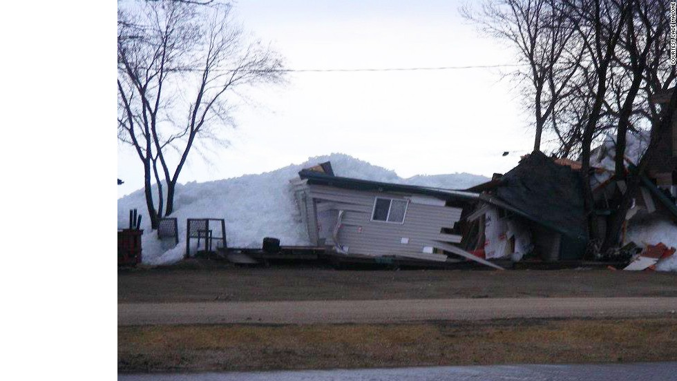 A house destroyed by the ice is shown on May 12.