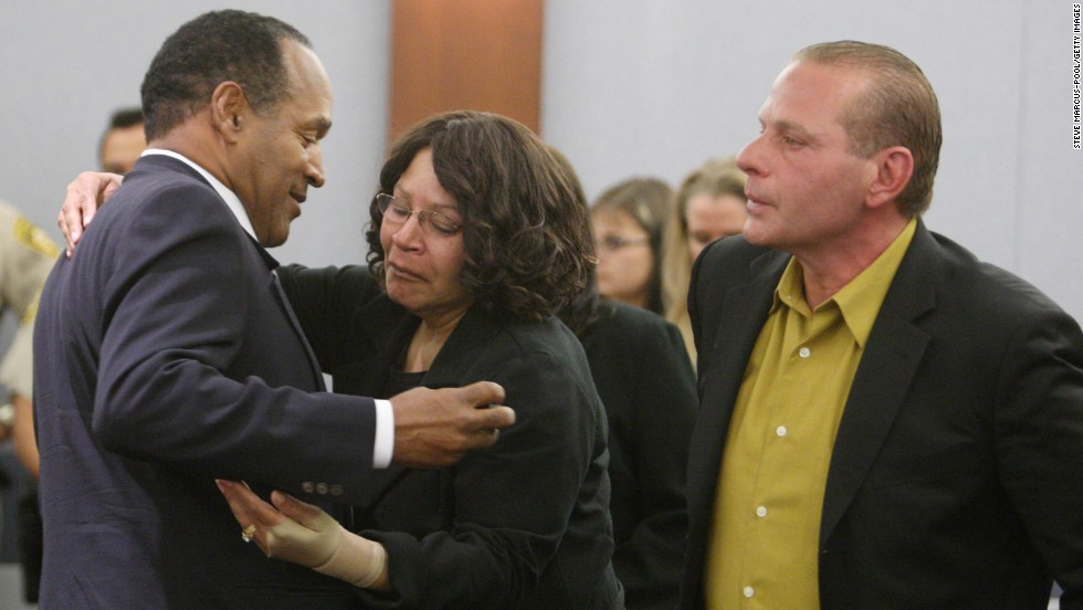Simpson embraces his sister, Carmelita Durio, while his friend Tom Scotto looks on in court after a guilty verdict was reached in October 2008. Simpson was convicted of leading a group of associates into a room at the Palace Station hotel and casino and using threats, guns and force to take back items from two dealers.