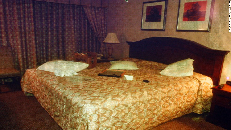 The Palace Station hotel room, the scene of Simpson's reported confrontation with sports memorabilia dealers, is displayed on a monitor during Simpson's trial in September 2008.