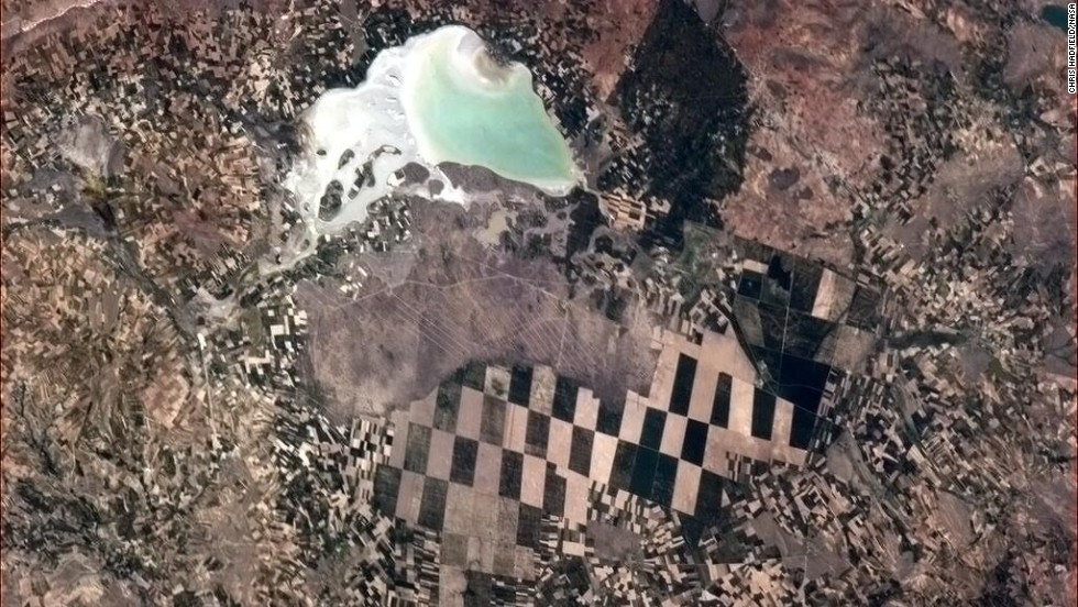 "A <a href=""https://twitter.com/Cmdr_Hadfield/status/332215204224057344"" target=""_blank"">checkerboard scene</a> below. ""Little farmers, big farmers and nature, in Turkey,"" Hadfield wrote on May 8."