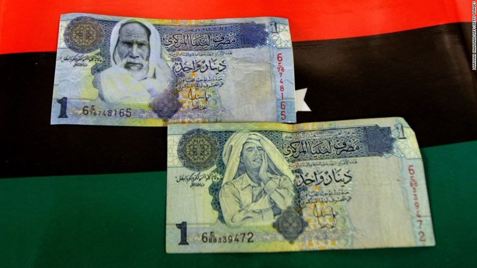 During the revolution, rebels forged one dinar notes showing Moammar Gadhafi in a contemplative pose, bottom, replacing his image with that of Omar Mukhtar, top, leader of the Libyan resistance to Italy in the early 20th century. Now new notes have been issued.