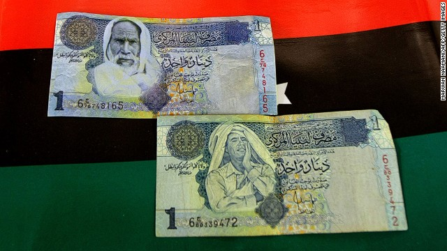 Forged notes subbing Moammar Gadhafi's image (bottom) with that of Omar Mukhtar have now been replaced with legitimate new one-dinar notes.