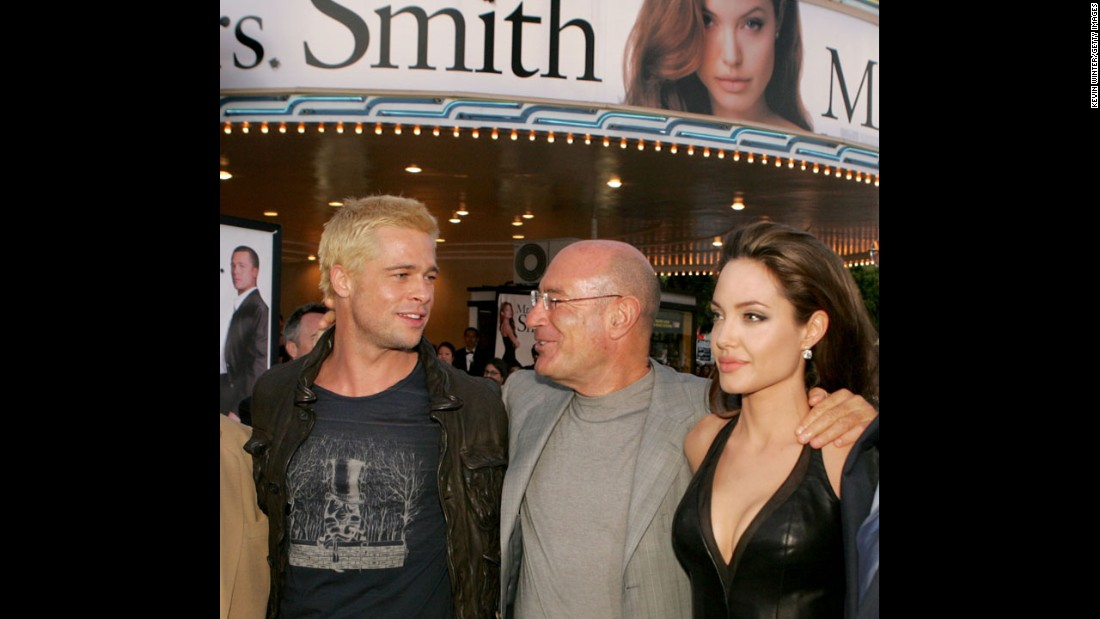 "Producer Arnon Milchan centers Jolie and actor Brad Pitt at the premiere of ""Mr. & Mrs. Smith"" in June 2005. Jolie and Pitt became a real-life couple and married in 2014."