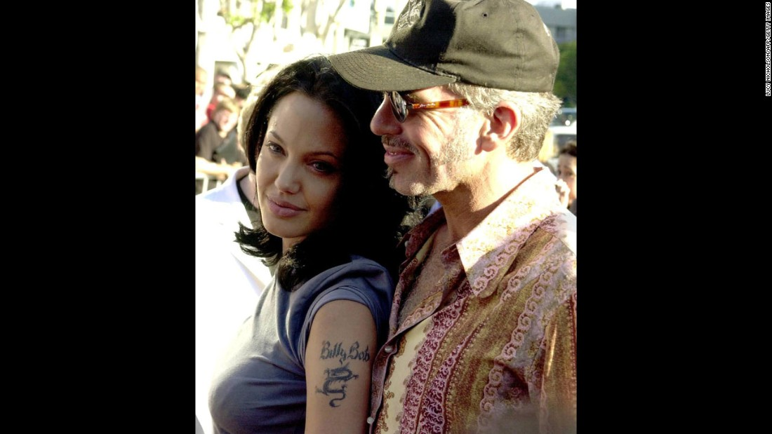 "Jolie and her husband at the time, Billy Bob Thornton, appear at the premiere of her film ""Gone in 60 Seconds"" in June 2000. They divorced in 2003."