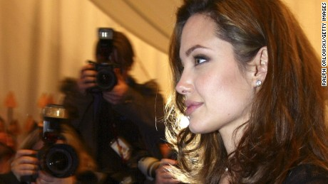 """COLOGNE, GERMANY - DECEMBER 17:  U.S. actress Angelina Jolie arrives for the German premiere of """"Alexander"""" at the Cinedom on December 17, 2004 in Cologne, Germany.  (Photo by Ralph Orlowski/Getty Images)"""