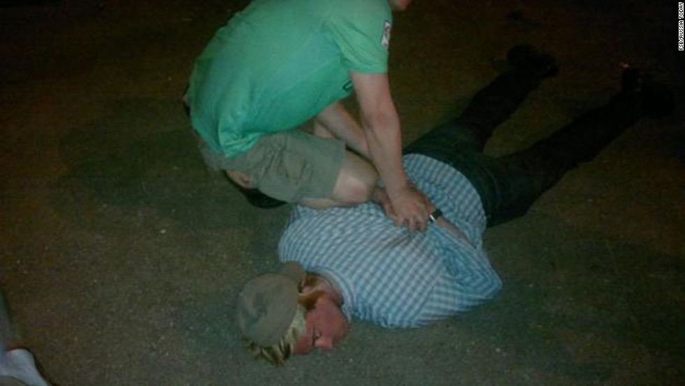 Russia's FSB counterintelligence agency released photos after it said it briefly detained a suspected member of the CIA who was trying to recruit a staff member of one of the Russian special services. Pictured, the man is handcuffed on the ground.