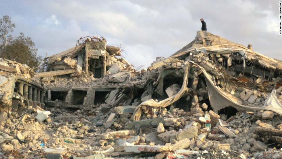 Anthony Bourdain atop the rubble that was once Moammar Gadhafi's compound in Tripoli.