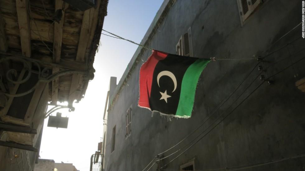 A Libyan flag hangs in an alleyway in Old Town, Tripoli.