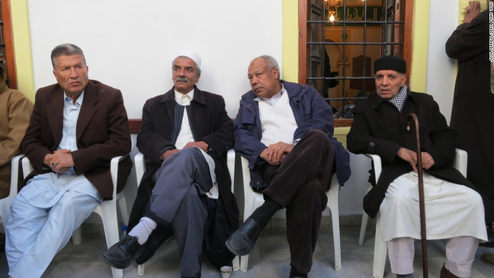 Men await a musical procession in Old Town, Tripoli, to celebrate Eid Milad un Nabi (Birth of the Prophet Mohammed).