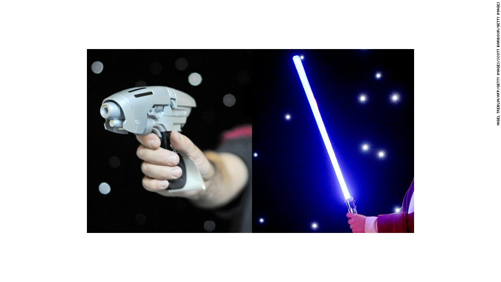 """Trek"" characters use various kinds of phasers, cannons, pistols, disruptors and lasers. The classic sword-like light saber dominates ""Star Wars,"" but characters also use blaster-type weapons. Photos: A phaser from the Enterprise NX-01 in ""Star Trek: Enterprise"" (left) and a light saber in Australia in June 2009."