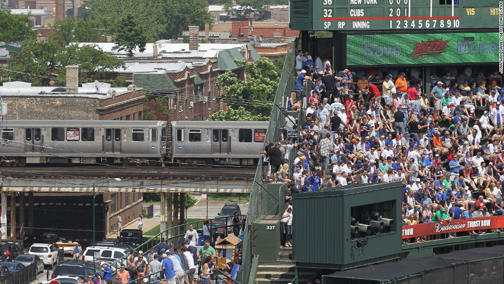 Chicago's Wrigley Field has a classic jewel box design -- green seats, open roof, exposed steel, brick, stone -- with ball-swallowing ivy-covered walls, bleacher bums and passing El trains.