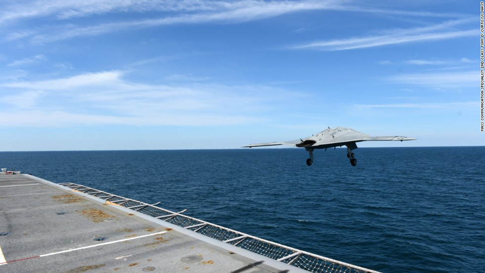 "An X-47B Unmanned Combat Air System  demonstrator leaves the flight deck of the aircraft carrier USS George H.W. Bush on Tuesday, May 14. <a href=""http://www.cnn.com/2013/05/14/us/navy-carrier-drone/index.html"">The drone, propelled by a catapult, was the first to be launched from an aircraft carrier.</a>"