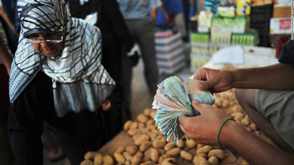 A vendor sells potatoes at the Rashid Street market in Tripoli on August 29, 2011.