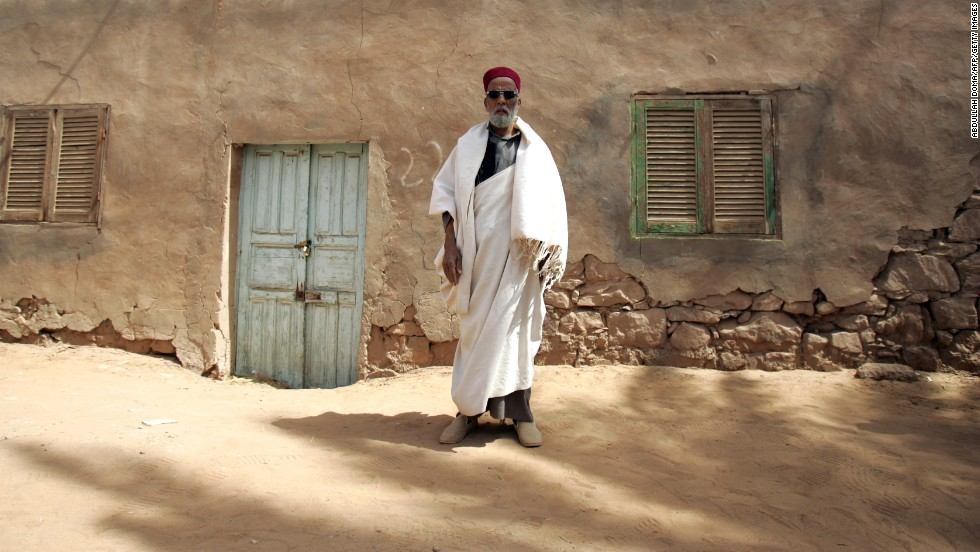 Mahamade Alsharif stands outside a house in Brak on March 15.