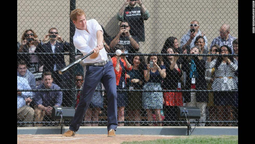 Prince Harry hits a baseball while participating in drills at the Harlem RBI baseball youth development program in New York City on Tuesday, May 14.