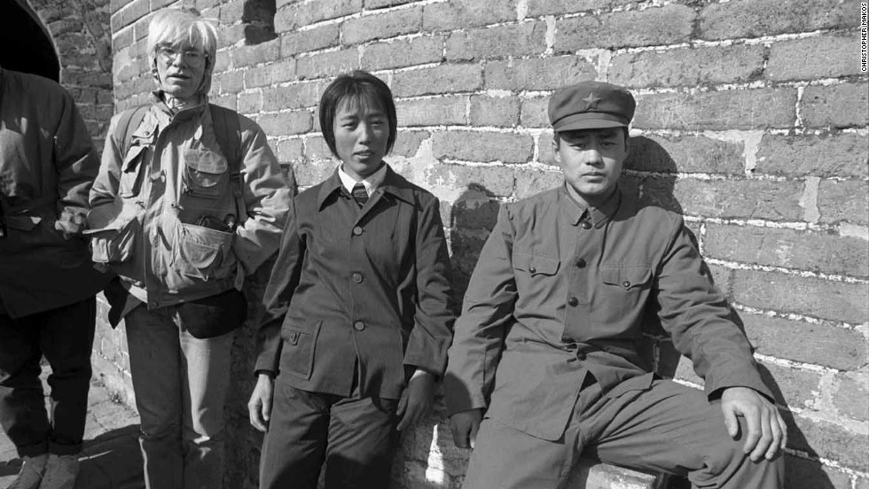 Warhol stands by Chinese citizens on the Great Wall of China.