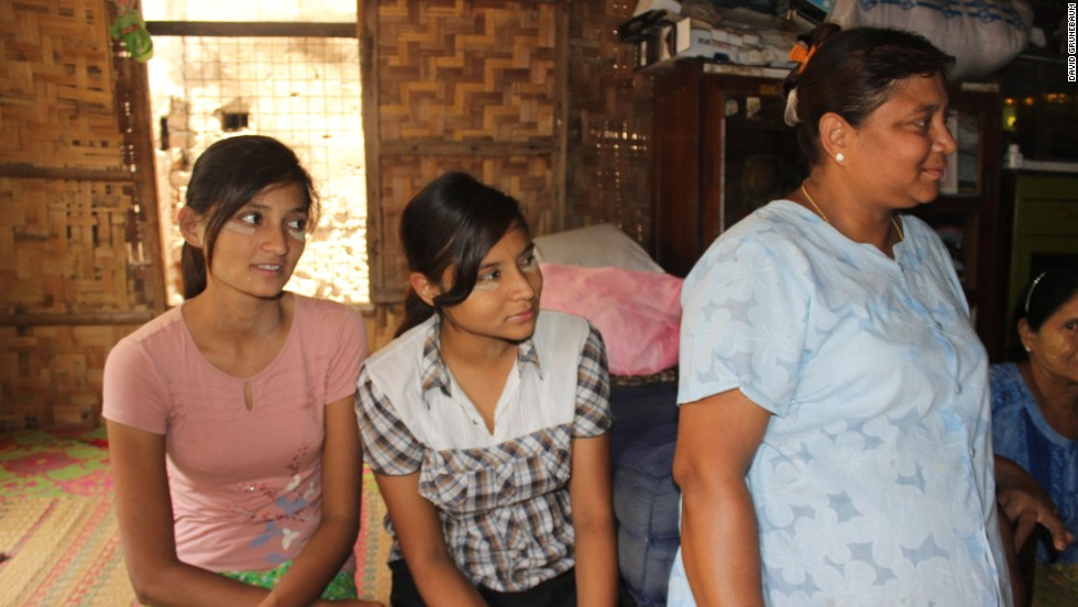 Thidar Hla (right) pictured at home in Meiktila with her two daughters: Hnin Ei Phyu (far left) and Moe Ei Phyu. They are one of thousands of families was forced to flee during clashes between Muslims and Buddhists.