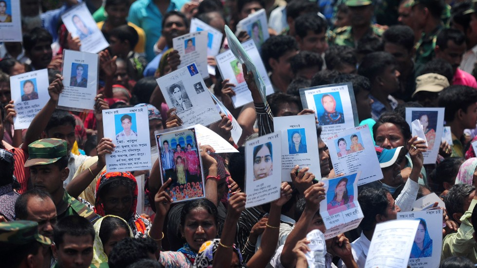 Family members of missing workers march on May 14. The Bangladeshi army has wrapped up its search for bodies.