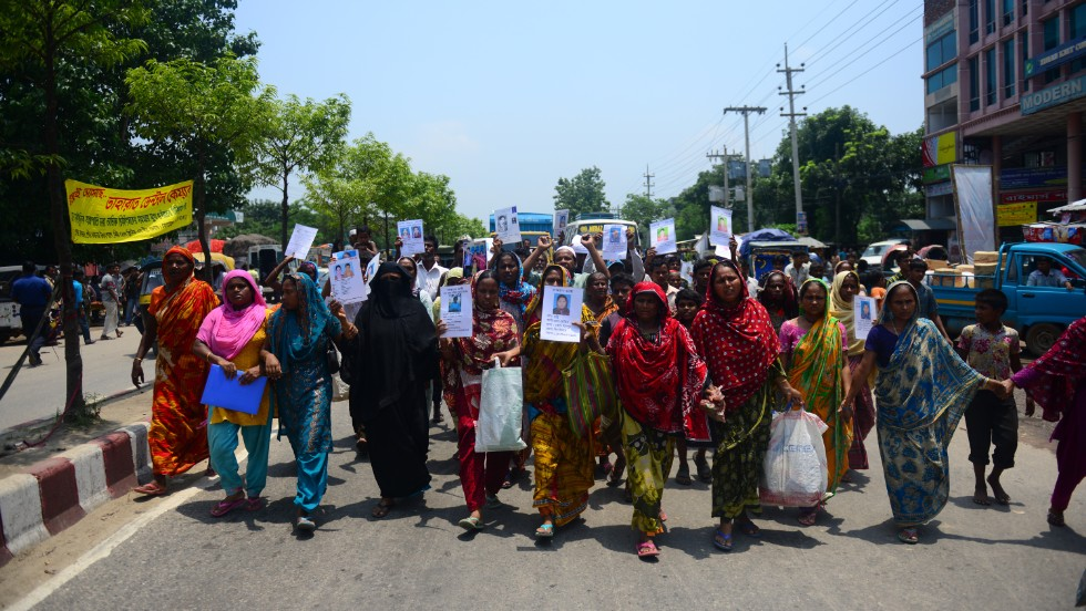 "Marching Bangladeshis hold up portraits of relatives missing in the Rana Plaza building collapse on Tuesday, May 14. They're demanding wages for the missing garment workers and the death sentence for the building owner. Rana Plaza collapsed on April 24 in Savar outside Dhaka; <a href=""http://www.cnn.com/2013/05/14/world/asia/bangladesh-building-collapse-aftermath/?hpt=hp_t2"">the final death toll stands at 1,127.</a>"