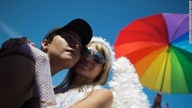(File) A gay couple poses during the gay pride parade in Rio de Janeiro, Brazil on November 18, 2012.
