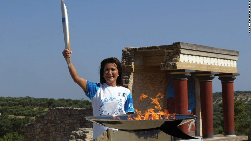 Holding an Olympic torch at the palace of Knossos in her hometown of Heraklion, Crete,  Angelopoulos is content.