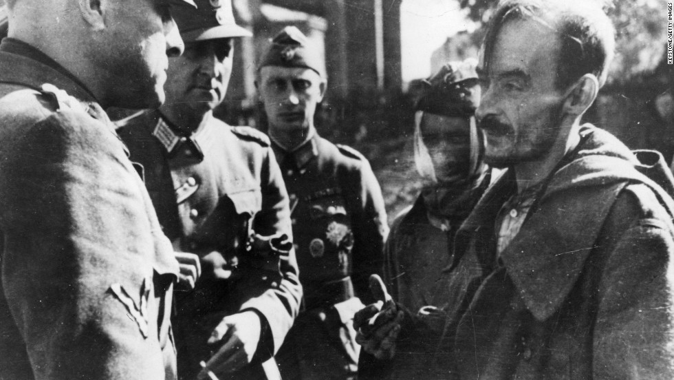 Only a handful of fighters survived the uprising.Pictured here is a Polish prisoner of war (right) being interrogated by German officers in Warsaw.