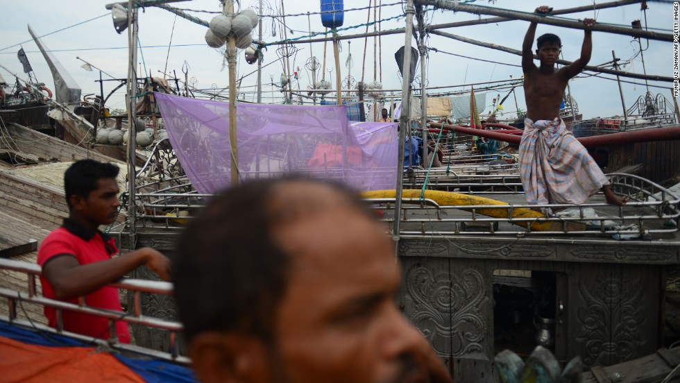Bangladeshi fishermen tie up their vessels in the Chittagong Harbor on Wednesday, May 15.