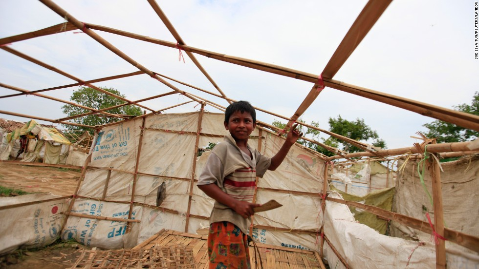 A boy dismantles his tent near Sittwe before moving to safer ground on Monday, May 13, in light of the approaching cyclone.