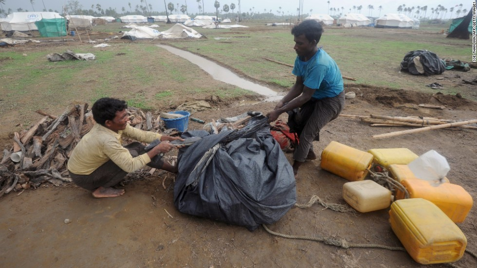 Rohingya men pack their belongings as they get ready for the move on May 16.