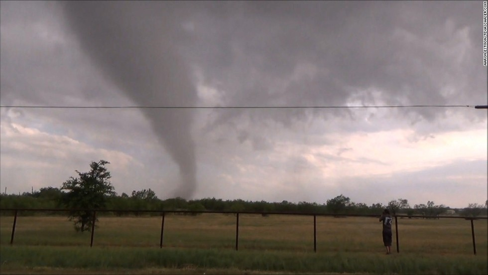 At least 10 tornadoes touched down in northern Texas late Wednesday May 15, including this one in Millsap, west of Fort Worth.