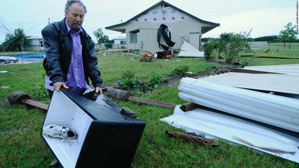 John Bouyer collects a refrigerator on May 16 that blew away from his sister-in-law's home in Granbury.