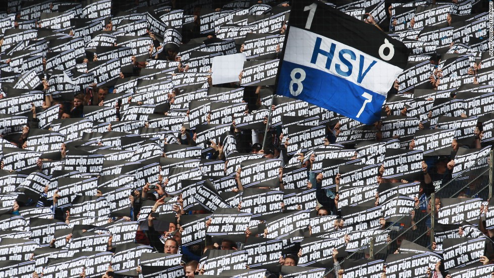 """All but three top-flight clubs -- Bayer Leverkusen, Wolfsburg and Hoffenheim -- are owned by supporters under the 50+1 rule, that dictates clubs must be majority owned by fans to prevent them being taken over by private investors. The last vote on changing the """"50+1"""" rule came back in 2009 and only Hannover 96 voted to scrap it. Here Hamburg fans hold up banners at a recent Bundesliga match against Hannover that reads: """"Us for you, you for us."""""""