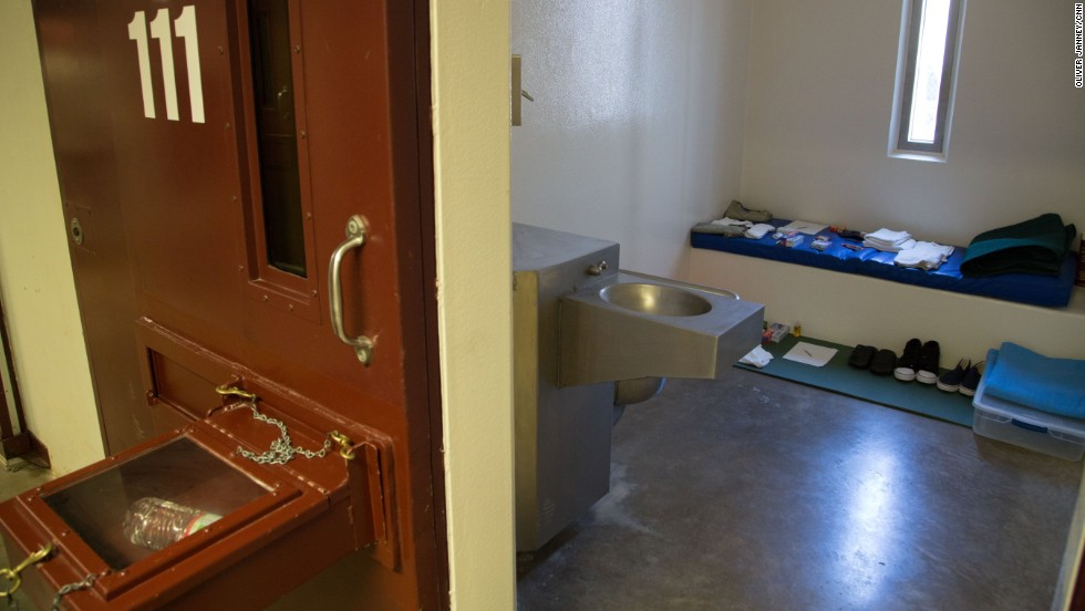 "The box protruding from a cell door is known as a ""splash box.""  It is used to keep detainees from being able to splash guards with bodily fluids, a practice that has become a daily occurrence since the start of the hunger strike."