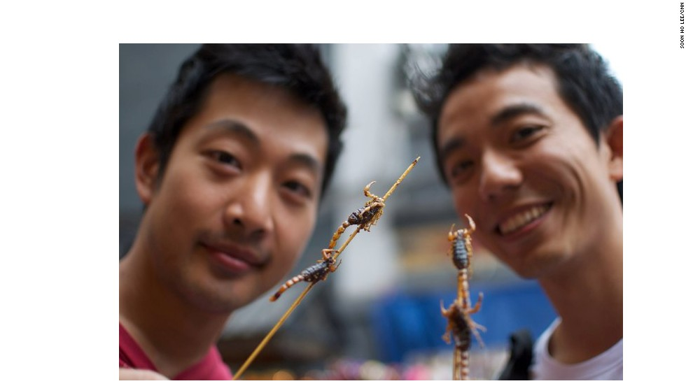"Although scorpions aren't technically 'insects,' they still made it onto the U.N. report. They're more of a tourist draw than conventional Chinese cuisine, and can be found at <a href=""http://travel.cnn.com/shanghai/life/5-extreme-foods-at-beijing-night-market-294439"">street stalls dotting Beijing's major shopping street of Wangfujing</a>. ""They taste like anything deep-fried -- crunchy and oily but no real flavor,"" says Soon Ho Lee, one of the adventurous tourists in this photo (left)."