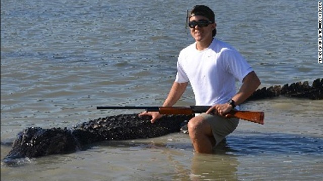 Teen nabs 800-pound alligator