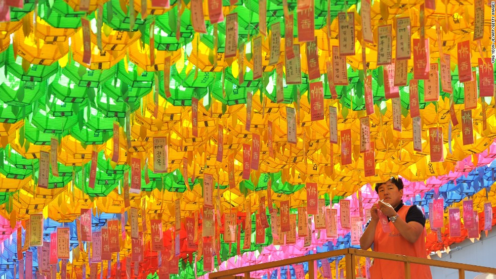 MAY 17 - SEOUL, SOUTH KOREA: Name cards with wishes of Buddhist followers are attached to lotus lanterns during a ceremony to celebrate the birthday of Buddha at Jogye temple. Buddhism is one of South Korea's largest and most active religions with millions of followers. Although the exact date is unknown, Buddha's official birthday is celebrated according to the lunisolar calendar, on the eighth day of the fourth month.