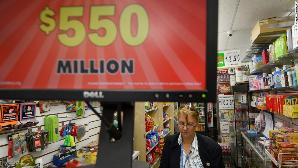 A woman buys a ticket near a sign for the Powerball lottery in New York on May 16. The odds of winning the jackpot are 1 in 175 million.