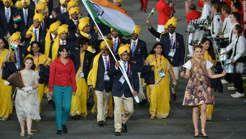 The Indian Olympic team's moment of glory at the 2012 London Games' Opening Ceremony was shared by a mystery woman in a red shirt and blue trousers who waved to the crowd as the delegation marched round the stadium. The woman was later revealed as Madhura Nagendra.