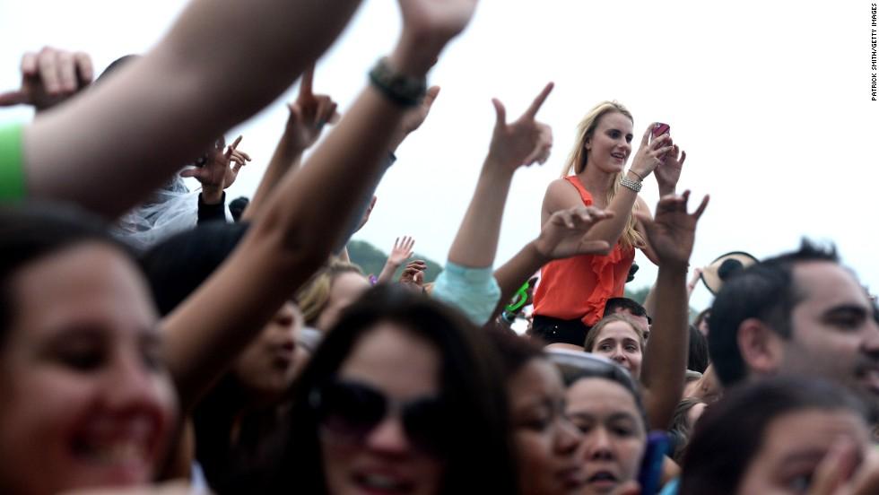 "Fans watch rapper Armando ""Pitbull"" Perez perform prior to the race."