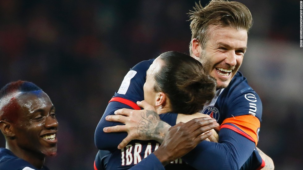Beckham hugs star striker Zlatan Ibrahimovic after the Swede's early opener in PSG's final home match of the season.