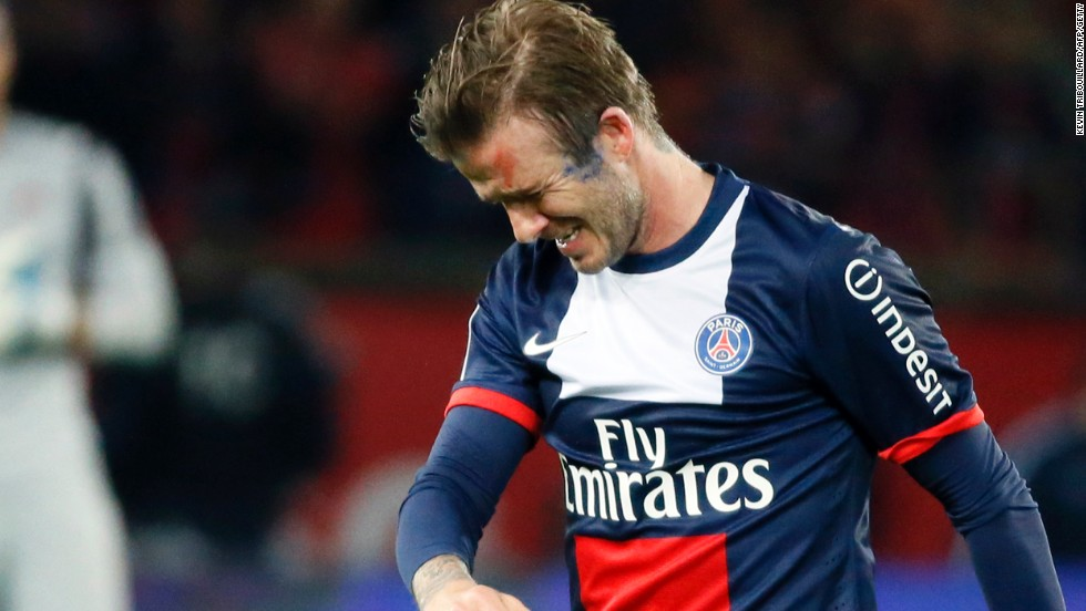 The emotion shows as David Beckham walks off the field after his late substitution at the Parc des Princes.