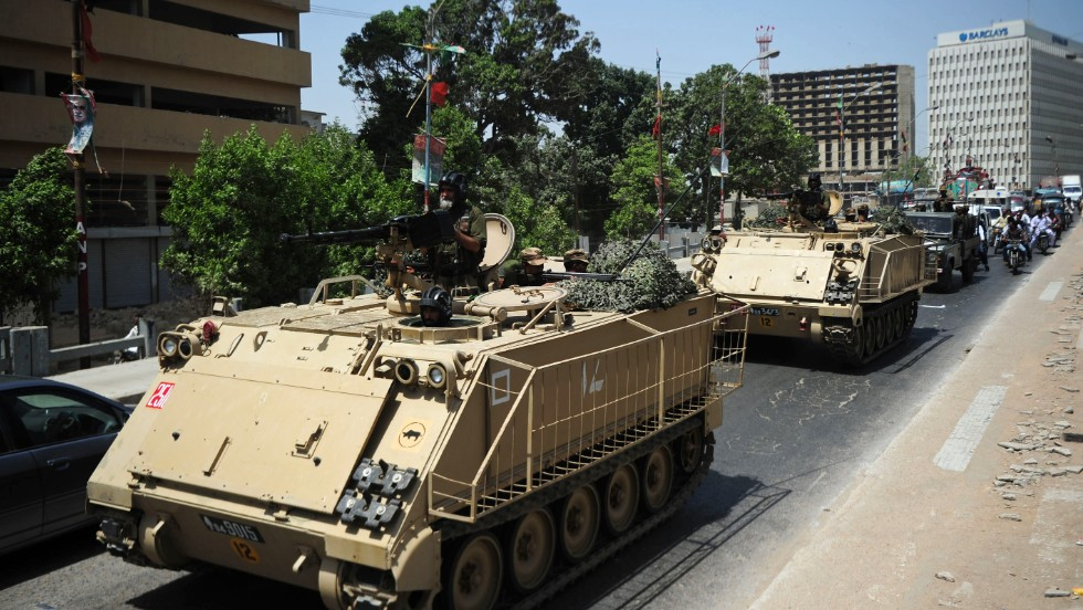 Pakistani tanks deploy near a voting station on May 18 ahead of a new vote in Karachi, where complaints of rigging and irregularities were reported in the general election May 11. The army is set to be deployed at 43 polling stations ahead of voting on May 19, a media report said.