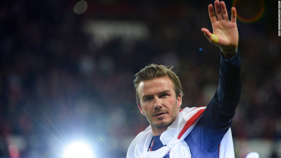 "Beckham waves after PSG played Brest in<a href=""http://www.cnn.com/2013/05/18/sport/football/football-psg-beckham-farewell-game/index.html?hpt=hp_t2"" target=""_blank""> his final home match</a> in May. Beckham had <a href=""http://news.blogs.cnn.com/2013/01/31/beckham-to-join-paris-saint-germain-club-says/"">signed on with the team</a> just a few months prior to his <a href=""http://www.cnn.com/2013/05/16/sport/football/david-beckham-retires-football/index.html?hpt=hp_t2"">retirement.</a>"