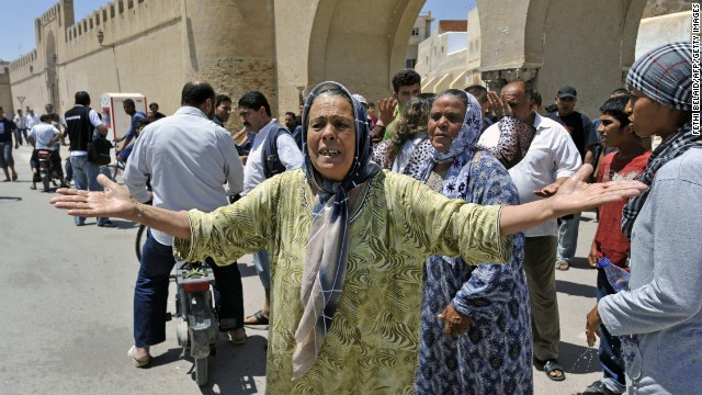 Tunisians shout insults at the police after they arrested a fellow resident from the southern Tunisian city of Kairouan.