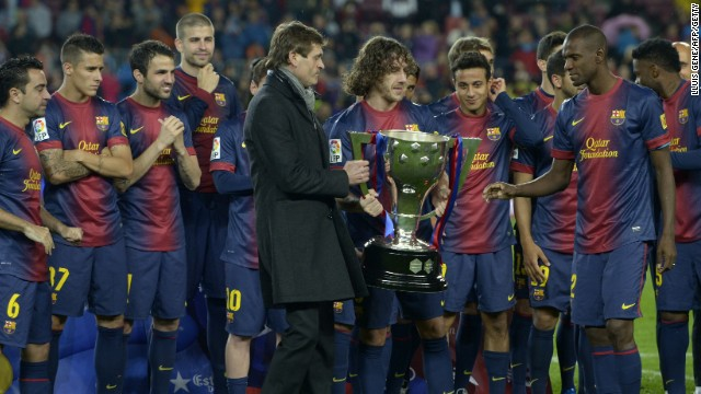 Carlos Puyol allows Tito Vilanova and Eric Abidal to lift the La Liga trophy in the Nou Camp.